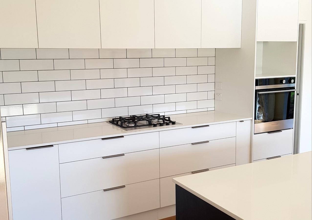 Modern white kitchen with subway tiles