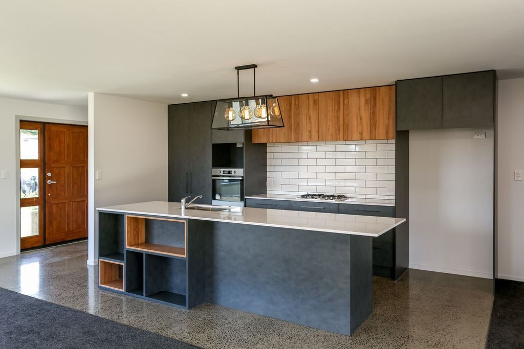 Grey and timber kitchen with cube storage and pendant light