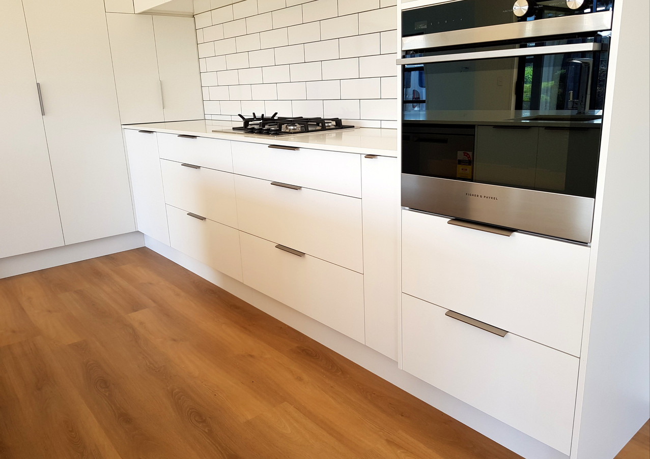 Gas cooktop in new white kitchen New Plymouth