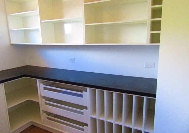 Scullery with open shelves and drawers for storing kitchenware