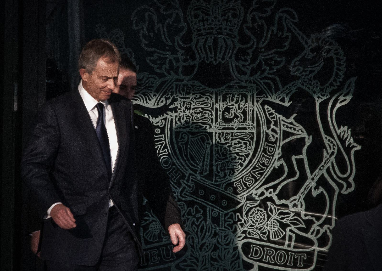 Tony Blair exiting war tribunal