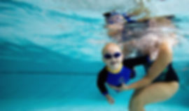 kid-swim-lesson_73800535-1024x600.jpg