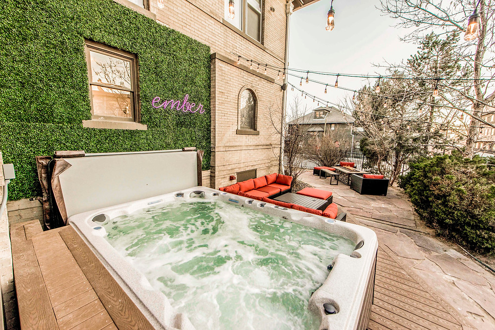 A bubbly hot tub at Ember Hostel in Denver, Colorado.