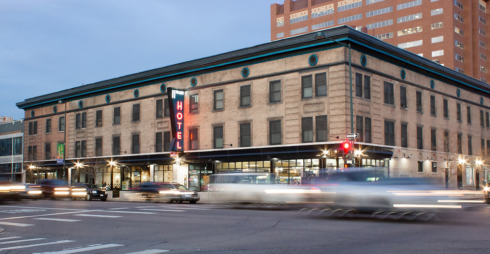 The exterior of the historic 11th Avenue Hostel in Denver, Colorado at dusk..