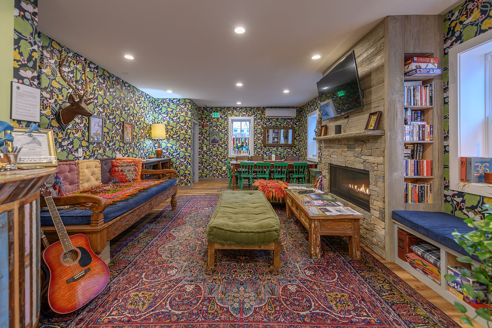 The colorful and lively lobby at Black Elephant Hostel in Portland, Maine.