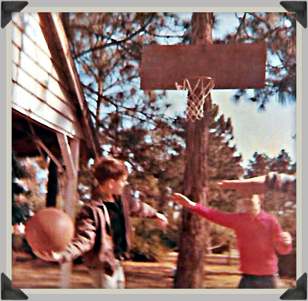 Doghill basketball.  Uncle Dave hook-shootin' over a red shirted brother Gary's staged defense. 1964