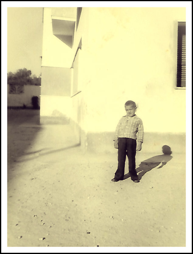 Uncle Dave looking as curious as George.  Tripoli, Libya apartment compound, 1958