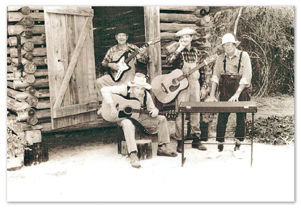 Daddy (Nugene) standing in the door. L-R: Rowe Lee (Neb), Charles Mathews (Newt), Elmer Shedd (Nub)