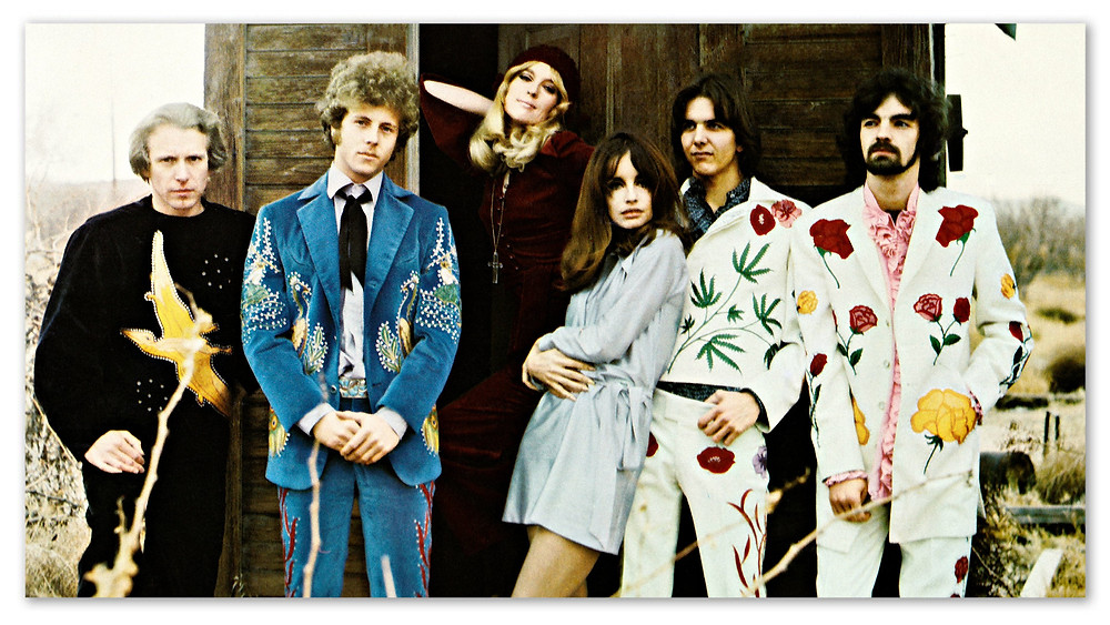 The Flying Burrito Brothers.  L-R: Kleinow, Hillman, 2 lovelies, Parsons, Ethridge.  Photo by Barry Feinstein.