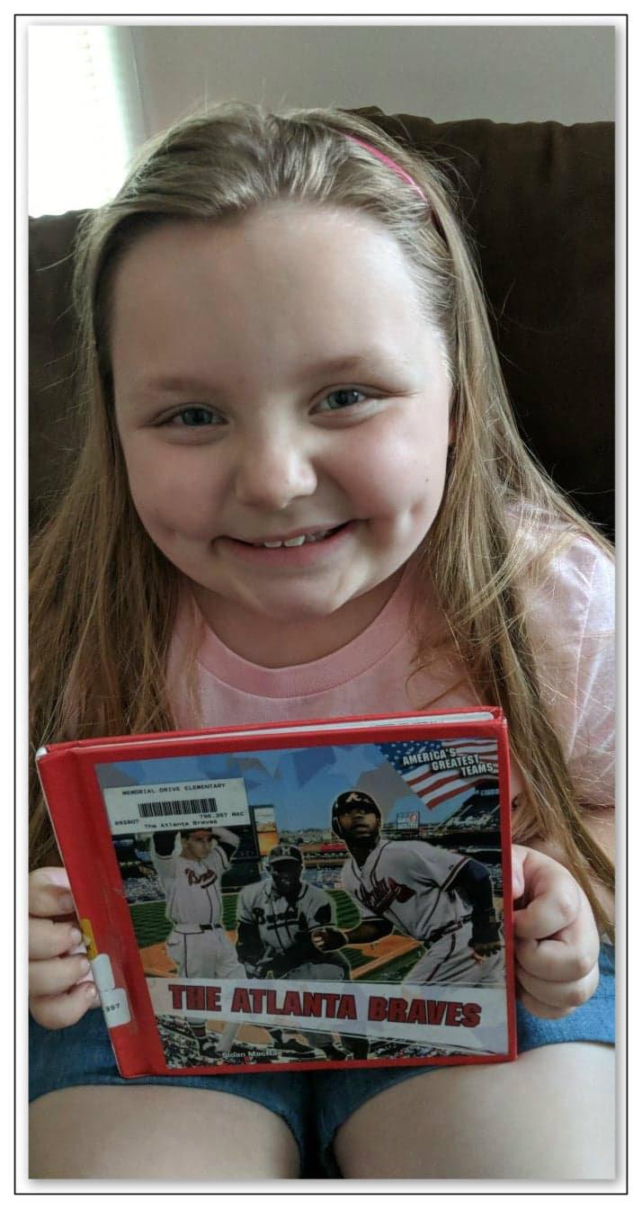 7-year-old Hannah, Braves fan like her Papa.