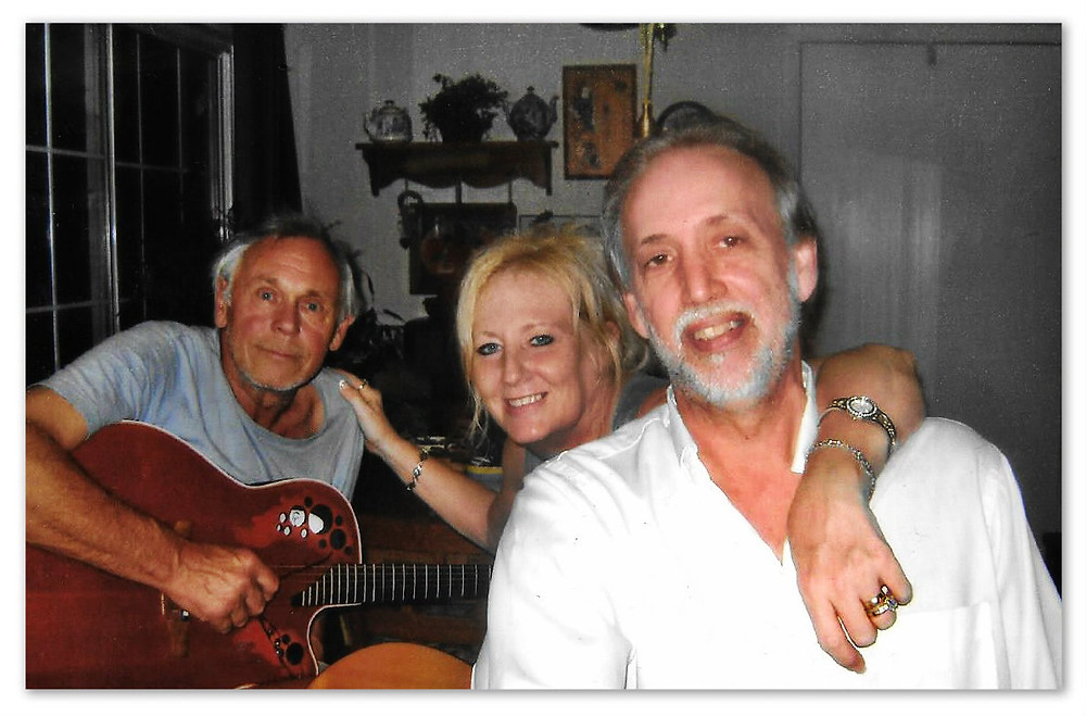 Ian, Aunt Lynne, and Uncle Dave having a kitchen songwriting session at home