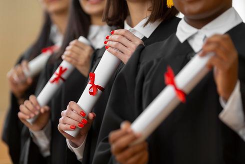 people-graduating-with-diplomas-close-up