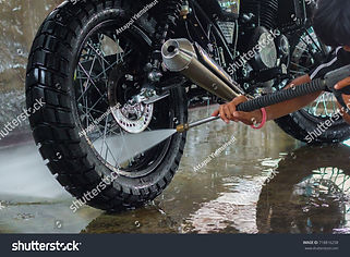stock-photo-a-man-cleaning-motorcycle-71