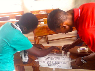 Mnindi Gets Desks from Whately Elementary School