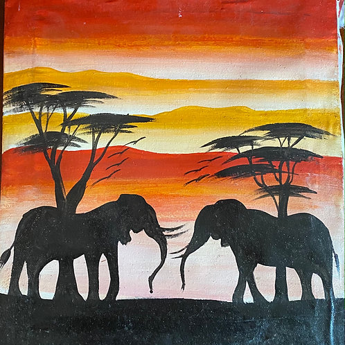 Elephant Silhouettes Under Trees