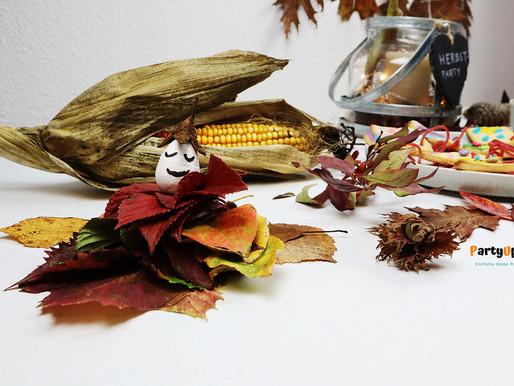 Blätter-Männchen Basteln mit Kindern im Herbst