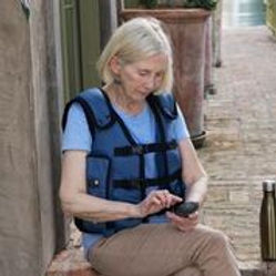 lady wearing Afflovest airway clearance device