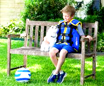 boy sitting on a bench wearing Afflovest percussion vest