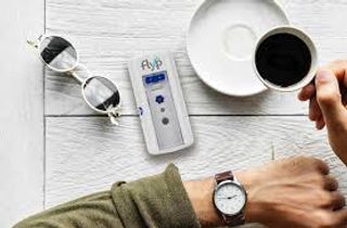 flyp nebulizer on table next to glasses and coffee cup