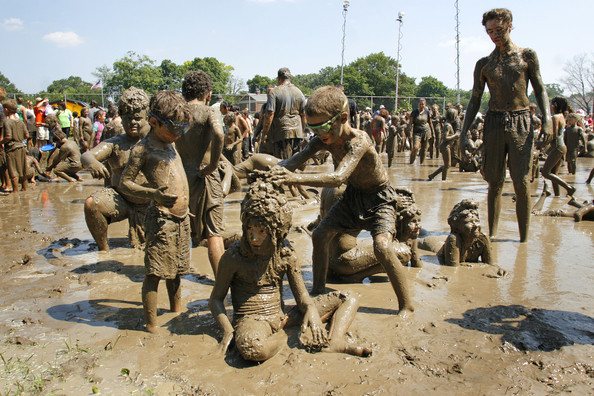Muddy kids at festival