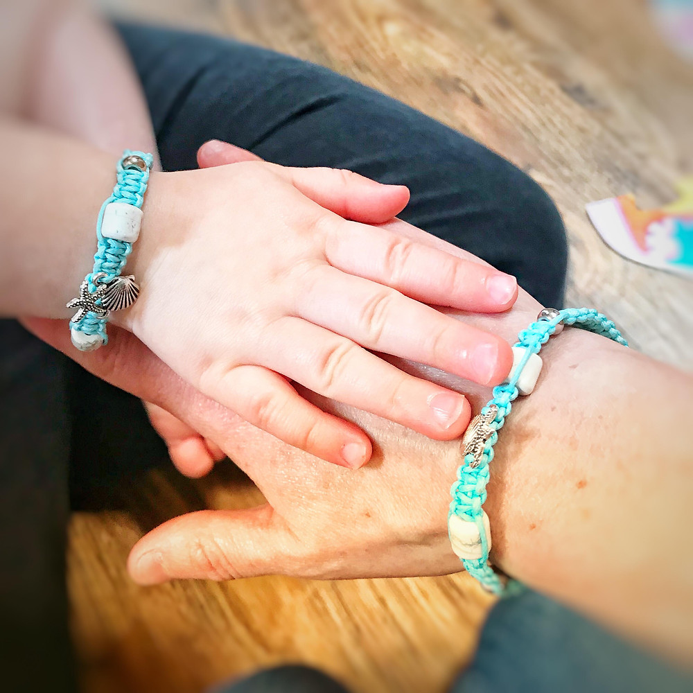 matching bracelets, mother and daughter