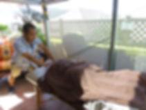Keita perform shiatsu treatment