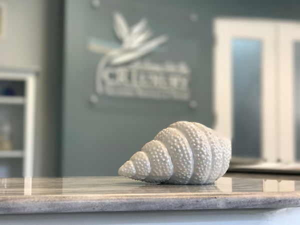 Luxury Sea Shell with Crluxury logo in background