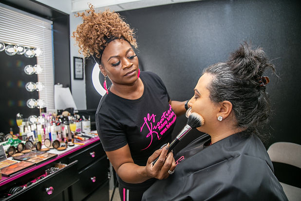 Fly adding setting powder after airbrush foundation, captured by Lacy of DPG Photography.