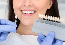 a dentist adding veneers