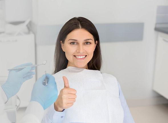 Woman Smiling at Aquadent Dental Care