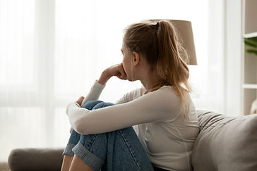 Side view young woman looking away at wi