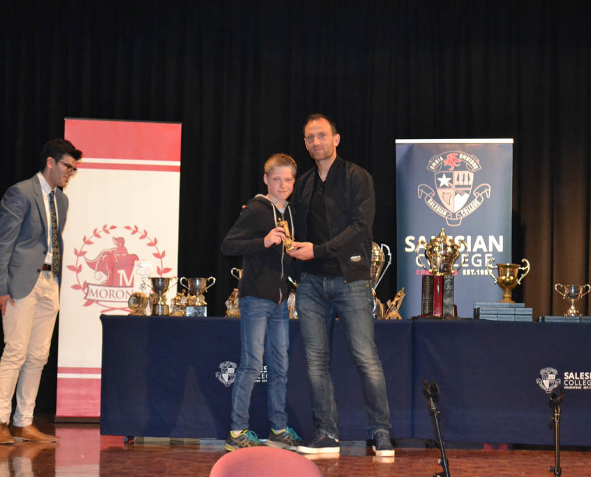 Melbourne City goalkeeper Eugene Galekovic handing out awards at Salesian College's school sports awards night.