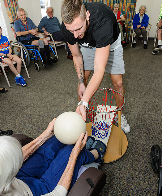 Adelaide 36ers captain Mitch Creek ran a modified skills clinic for residents at Life Care's aged care facility.