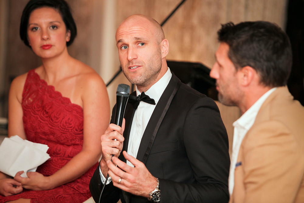 AFL legend Chris Judd speaks at a charity event