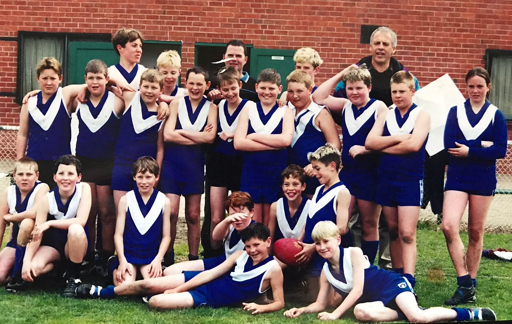 Daisy Pearce with her junior footy team