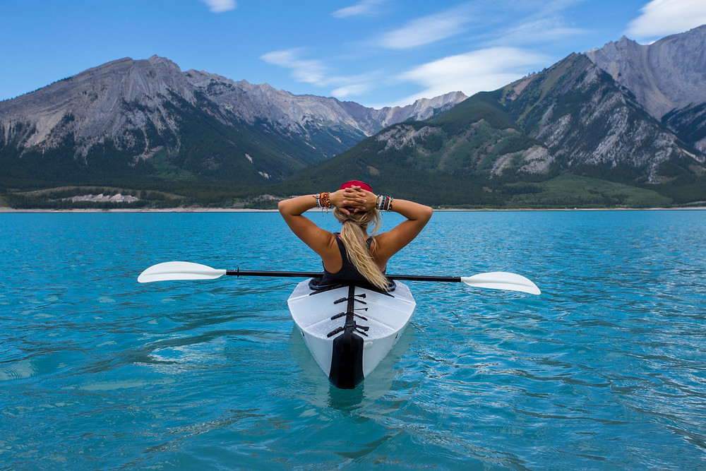 Woman traveling on kayak wearing bracelets.