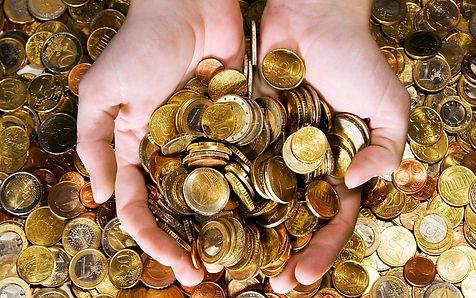 Manos dinero monedas olor.jpg