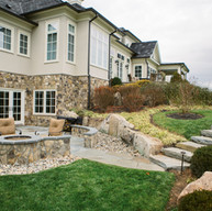 Patio with firepit and boulder steps