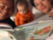 Parents reading to their baby