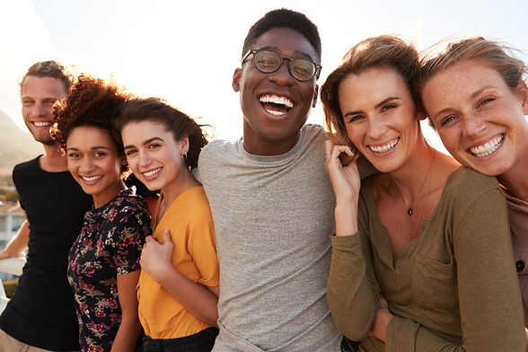Portrait Of Smiling Young Friends Walkin