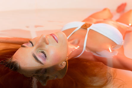 Wellness - young woman floating in Spa o