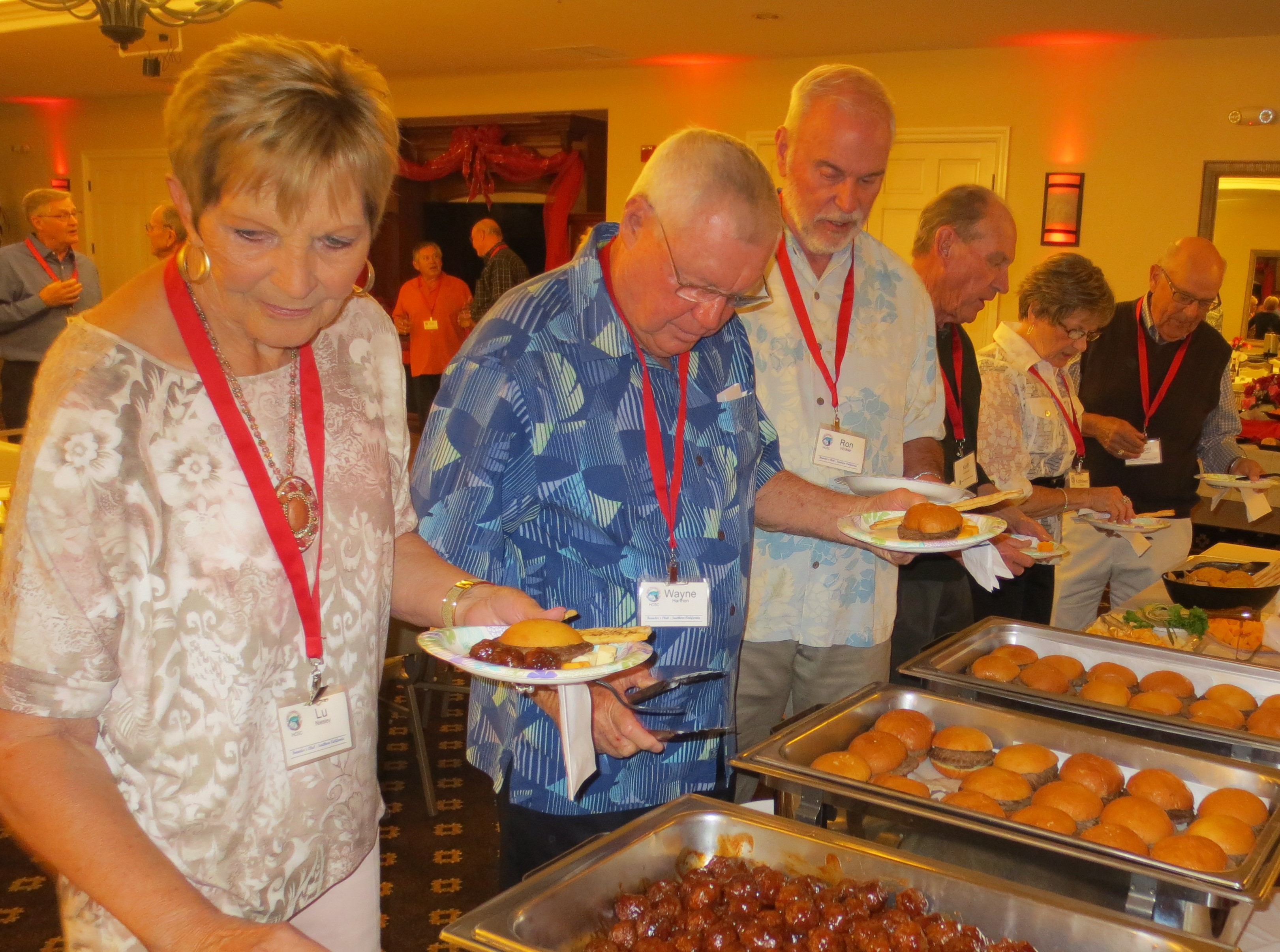 HCSC guests including Lu Niesley, Wayne Harmon and Ron   Winkler in the buffet line.
