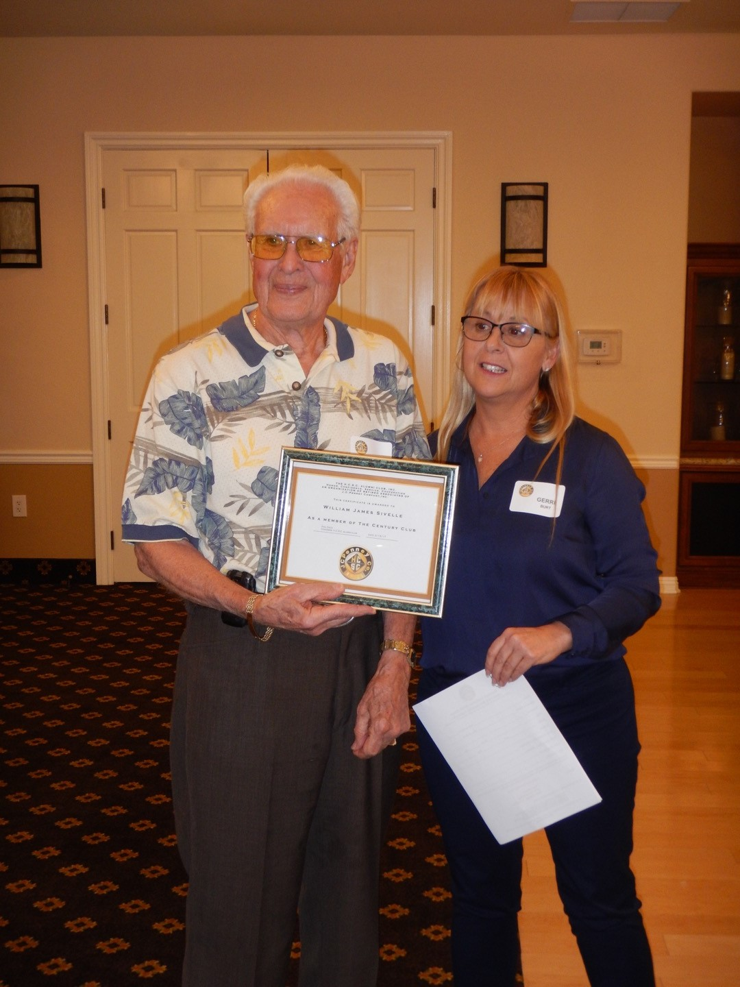 Jim Sivelle is recognized with  Membership In the CENTURY CLUB presented by President Gerri Burt
