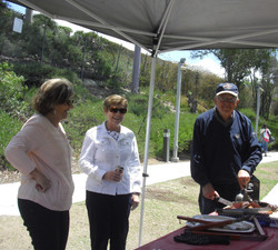 Kay Salzetti and Sue Steele watch Ron Salzetti Carving Tri  Tip Steaks - Copy