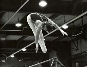 KU gymnast Gerald Carley competing at high bar