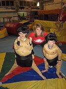 2 young boys and a teenage girl pose