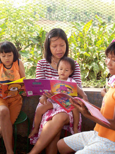 YE Mobile Library Programme mother reading to her child