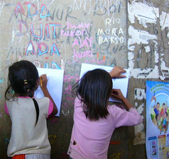 YE children in scavenger community drawing together