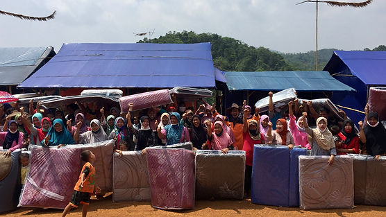 YE Disaster Relief and Recovery distribution of mattresses to families living in tents