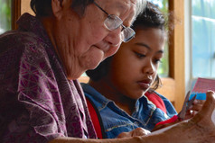 YE Mobile Library Programme children reading with grandmothers